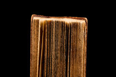 ancient book shot on black background Stock Photo