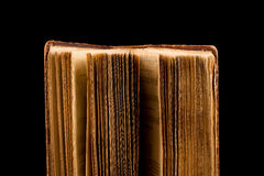 ancient book shot on black background Stock Image