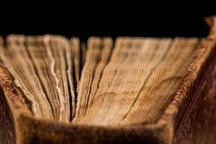 ancient book shot on black background Royalty Free Stock Images