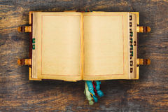 Ancient book on a wooden background Stock Photography