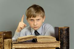 Ancient books a boy , a child Prodigy Royalty Free Stock Image
