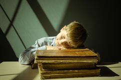 Ancient books a boy , a child Prodigy Stock Photo