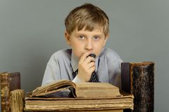Ancient books a boy , a child Prodigy Stock Image