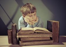 Ancient books a boy , a child Prodigy Stock Images