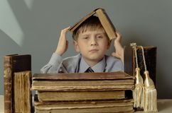 Ancient books a boy , a child Prodigy Royalty Free Stock Photos