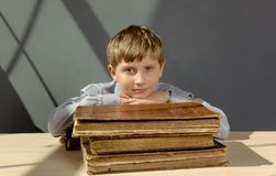 Ancient books a boy , a child Prodigy Royalty Free Stock Images