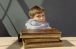 Ancient books a boy , a child Prodigy Stock Photography