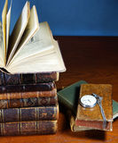 Ancient books and the clock Stock Image