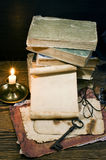 Ancient books on the old paper background Stock Photos