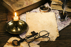 Ancient books on the old paper background Royalty Free Stock Photos