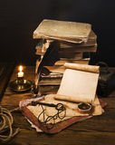 Ancient books on the old paper background Stock Images