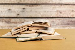 Ancient books on wooden desk. Ancient books paper art abstract brown dark Royalty Free Stock Image