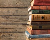 Old books on dark  background. Ancient books paper art abstract brown dark Stock Image