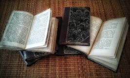 Ancient books. On a wicker table Stock Images
