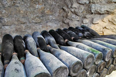 The ancient bottles of wine in the ancient cellar. The unique vi Royalty Free Stock Photo