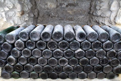The ancient bottles of wine in the ancient cellar. The unique vi Stock Images