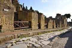 Ancient Boulder Street with Sidewalks, Herculaneum. Rocky Road, Kerb Stones and Sidewalk in Ancient Herculaneum. Herculaneum was buried in the eruption of Mount Royalty Free Stock Image