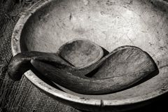 Ancient bowl and utensils in black and white. Carved bowl and utensils made from horn and bone - native american or ancient cultures Stock Photo