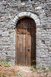 Ancient bown wood door in Gjirokaster Royalty Free Stock Photography