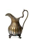 Ancient brass ewer  on white. Background Royalty Free Stock Image