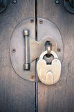 Ancient brass lock on wooden door with handle Royalty Free Stock Photos