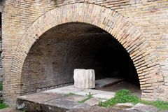 Ancient brick arch at small Roman theater in Taorm Royalty Free Stock Images