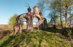Ancient brick entrance gates to the old cemetery Royalty Free Stock Photo