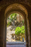 Ancient brick passageway door in the famous La Alcazaba in Malag Royalty Free Stock Photography