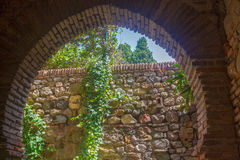 Ancient brick passageway door in the famous La Alcazaba in Malag Stock Photography