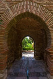 Ancient brick passageway door in the famous La Alcazaba in Malag Stock Photo