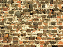 Ancient brick wall. Old brick wall with visible damage and erosion - different colour bricks Royalty Free Stock Photography