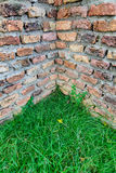 Ancient brick wall corner and grass Stock Image