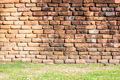 Ancient brick wall and grass background Royalty Free Stock Image