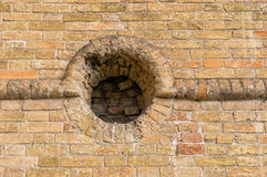 Ancient brick wall with round embrasure. In Popov Castle located in town of Vasylivka, Ukraine stock images