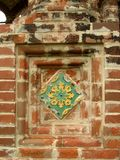 Ancient brick wall with tile Stock Photography