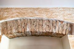 ancient brick wall under modern plastering stock image