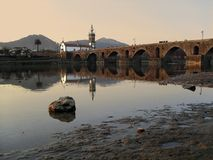 Ancient Bridge. Church and ancient bridge over river Lima, Portugal Royalty Free Stock Photo