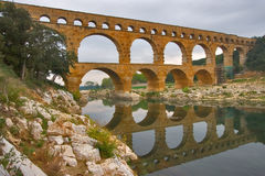 The ancient bridge. The well-known antique bridge-aqueduct Pont du Gard in Provence stock photography
