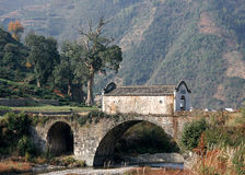 Ancient bridge, Anhui, China. Ancient bridge in AnHui Province, China. The cannel was used as trade route in ancient time Royalty Free Stock Image