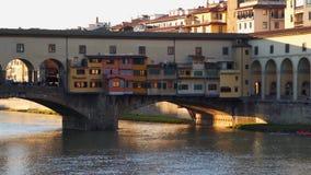 Ancient Bridge called Ponte Vecchio in Florence over Arno River.  stock video