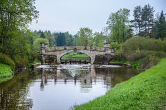 Ancient bridge.  Landscape is idyllic. Pavlovsk Park, city of Pavlovsk. The kings Park. Landscape is idyllic. The forest and the lake in loue, Park. Summer day Royalty Free Stock Images