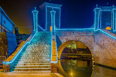 Ancient bridge at night lit by Christmas lights Royalty Free Stock Photography