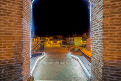 Ancient bridge at night lit by Christmas lights Stock Photo