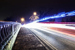 Ancient bridge at night with slow shutter speed Stock Images