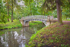 Ancient bridge over flow in the palace park in Gatchina Royalty Free Stock Photography
