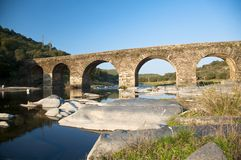 Ancient bridge on a river in salamanca. Ancient stone bridge on a river in salamanca spain Royalty Free Stock Images