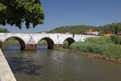 Ancient bridge in Silves. Ancient Roman bridge over Arade River in Silves, Algarve Portugal Royalty Free Stock Images