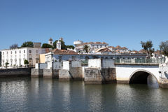 Ancient bridge in Tavira, Portugal Stock Photo