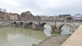 Ancient Bridge on the Tiber River in Rome Royalty Free Stock Photography
