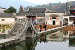Ancient bridge in Unesco water village Hongcun, province Anhui, China. Ancient bridge over the lake in the famous Unesco village of Hongcun in the province Anhui Royalty Free Stock Photo